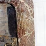 Côtés d'une cheminée en raccord avec la façade